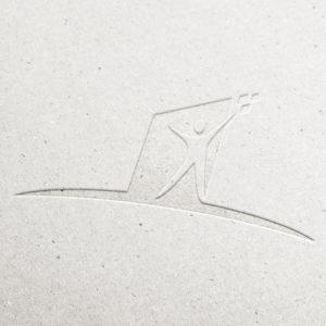 Mensch Logo geprägt in Karton
